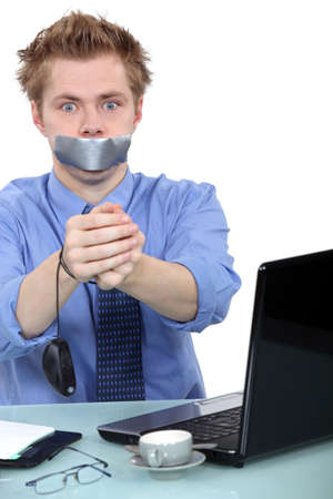 censorship: Man with mouth taped up Stock Photo
