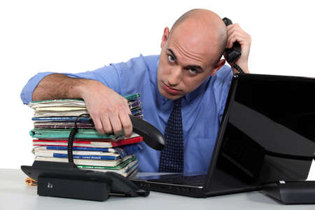 too much: business man too busy Stock Photo
