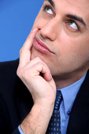 chew over: Close-up shot of a pensive businessman