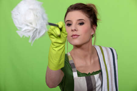dusting: Woman dusting Stock Photo