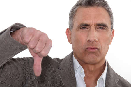 opposition: Unhappy grey-haired man Stock Photo