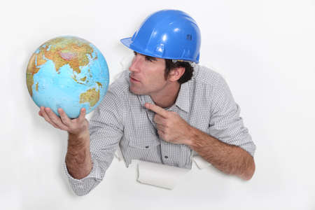 terrestrial: Builder angrily pointing at globe