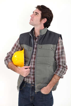 Construction worker staring off into space photo