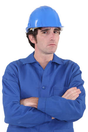 startled: Confused builder with crossed-arms