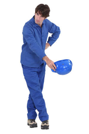 curtsy: Construction worker taking a bow Stock Photo