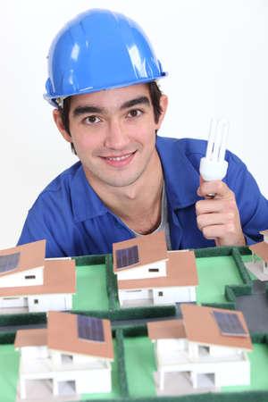 An electrician lighting a miniature Stock Photo - 15263183