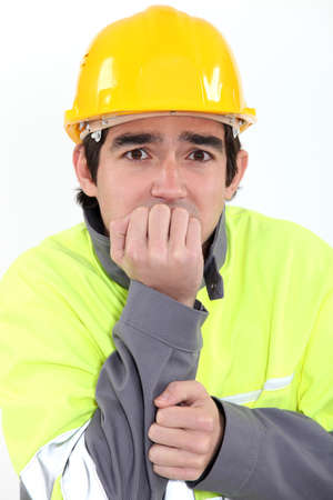 fearful: Fearful young worker Stock Photo