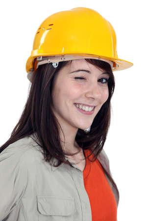 clin d oeil: Clin d'oeil � partir d'un travailleur de la construction f�minin Banque d'images
