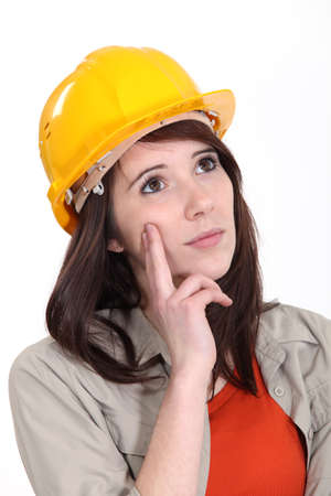deep thought: Tradeswoman daydreaming