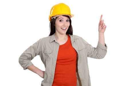 Female construction worker holding up her finger photo