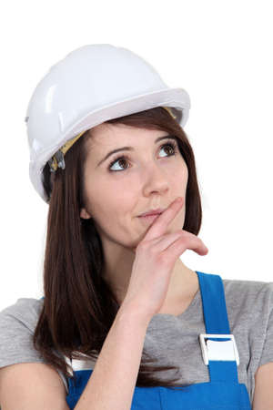 hand over: Portrait of a tradeswoman deliberating Stock Photo