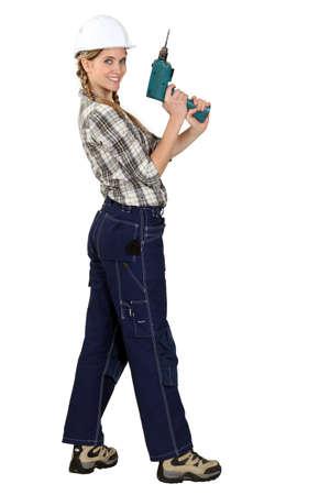 tradeswoman: Tradeswoman holding a screwdriver