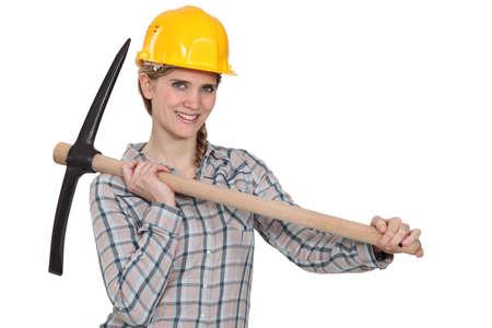 workwoman: Tradeswoman holding a pickaxe Stock Photo