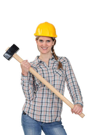 yourselfer: Happy handywoman holding a hammer