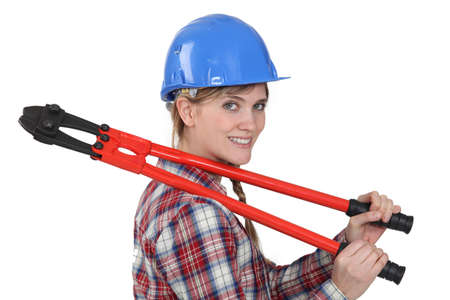tradeswoman: Tradeswoman holding large clippers Stock Photo