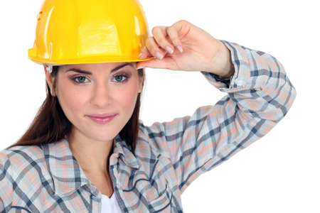 brim: Woman touching the brim of her hard hat