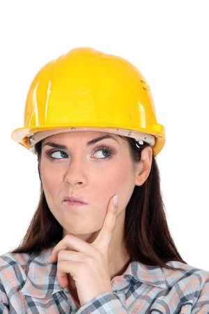 pouty: Woman with yellow helmet