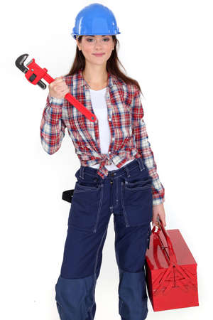 knotted: Tradeswoman holding a pipe wrench