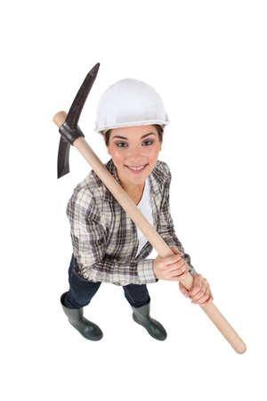 craftswoman: craftswoman holding a pickaxe