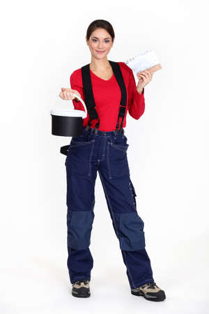 Woman plasterer on white background photo