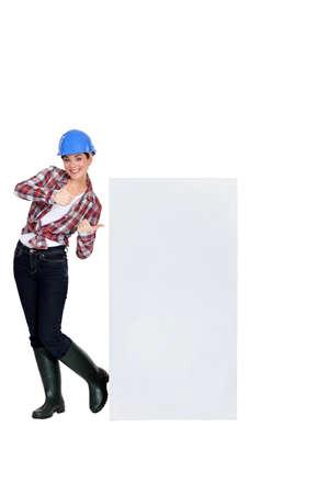lumberman: craftswoman pointing at copyspace Stock Photo