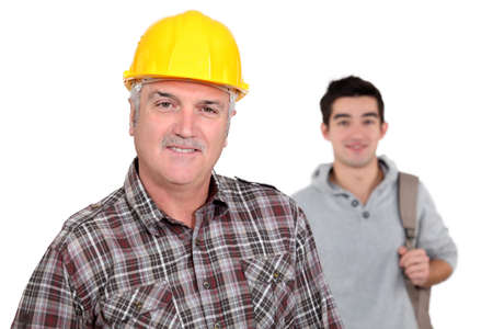 45 50 years: mature craftsman with apprentice in background Stock Photo