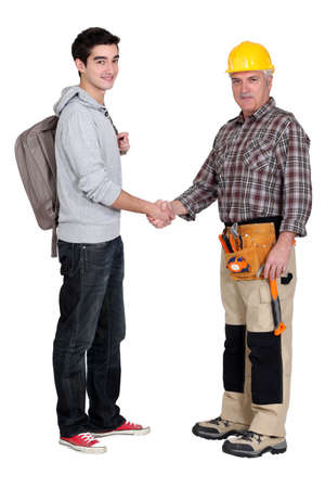 greet: Experienced tradesman meeting his new apprentice for the first time