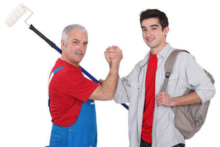 Experienced tradesman making a pact with his new apprentice Stock Photo - 15263324