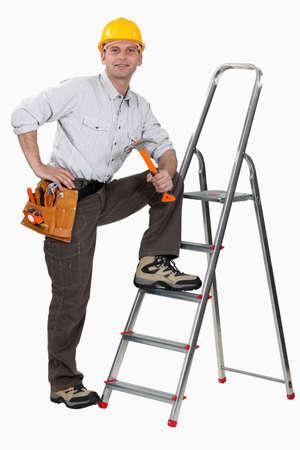 journeyman technician: Worker with a stepladder