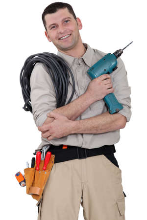 congenial: Friendly electrician with a drill Stock Photo