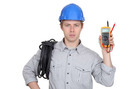 ammeter: Electrician showing multimeter