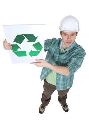 urging: Builder with a recycling logo