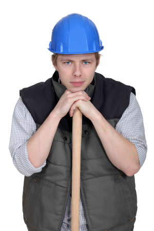Man resting head on sledge-hammer Stock Photo - 15258269