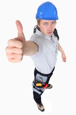 austere: An austere tradesman giving the thumb Stock Photo