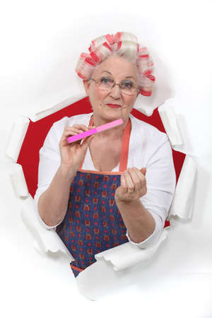 drab: Old fashioned woman wearing hair rollers
