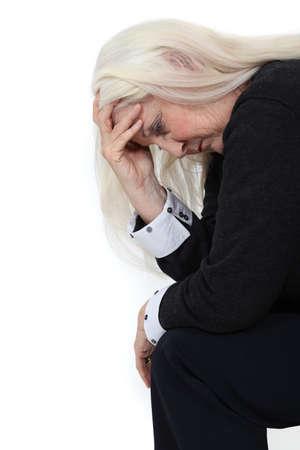 Elderly woman grieving Stock Photo