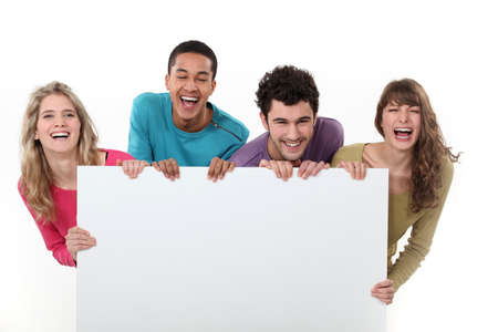 Laughing people holding a board left blank for your message photo