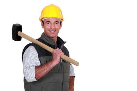 sledgehammer: Man resting sledge-hammer on shoulder