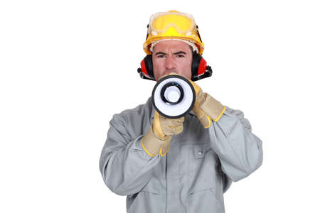 noise isolation: Construction worker with a loudspeaker