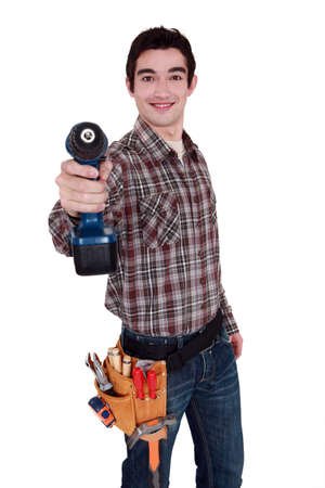 amend: Worker holding cordless drill Stock Photo