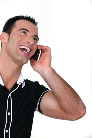 Man on the phone laughing photo