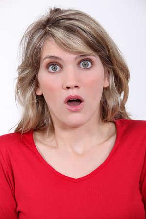 woman looking surprised photo
