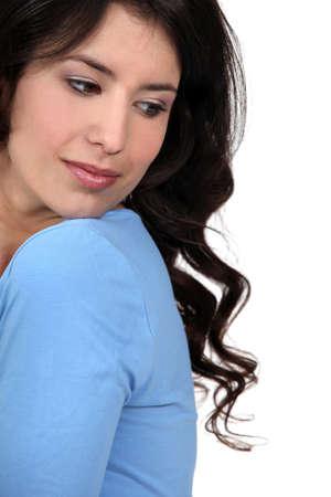 looking over shoulder: Brunette looking over her shoulder