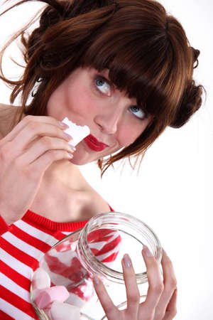 ingest: Woman eating candy Stock Photo
