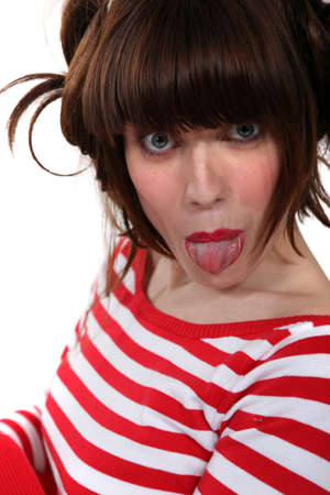 Woman sticking out her tongue Stock Photo - 15263272