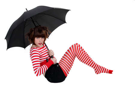 the girl in stockings: sexy woman in striped stockings holding umbrella