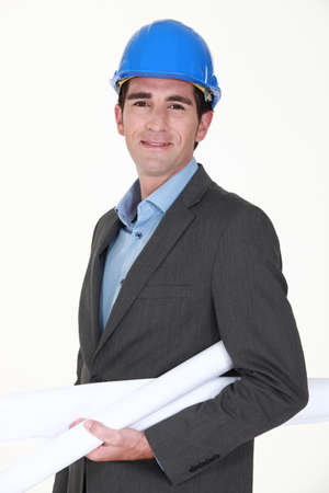 savvy: Engineer carrying rolled-up blueprints Stock Photo