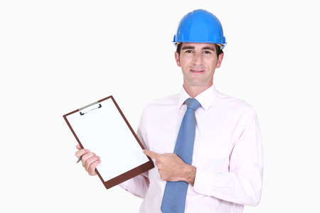 engineering clipboard: Surveyor pointing to his clipboard