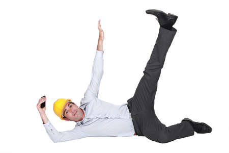 man nuts: An architect in a weird pose  Stock Photo