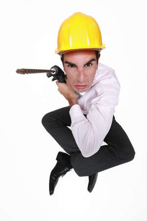 electric drill: Angry man holding power drill Stock Photo